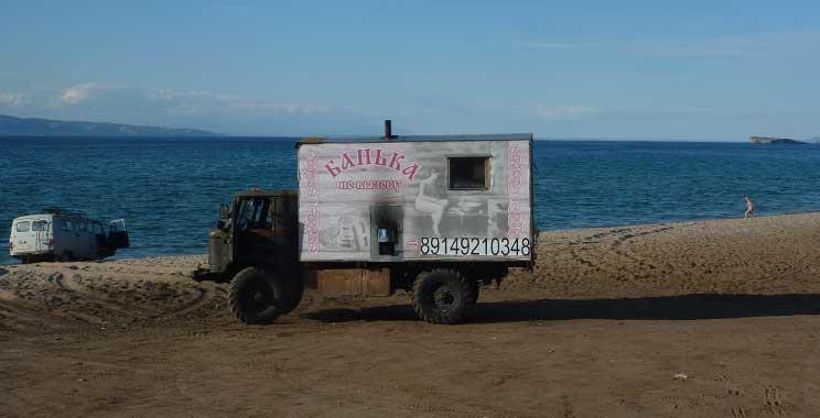 Russian portable sauna in an ex Soviet army truck on a beach by Lake Baikal